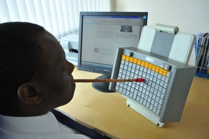 Maltron Head or Mouth stick keyboard in use